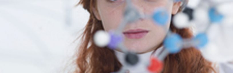 Female scientist looking at a molecule structure
