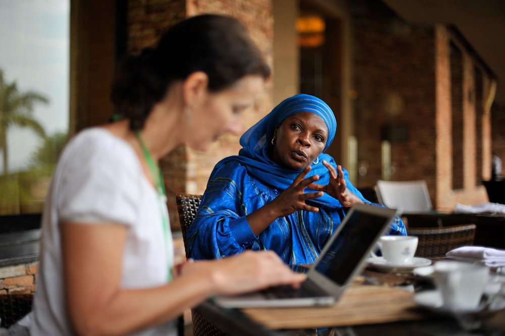 An African and European woman sharing ideas