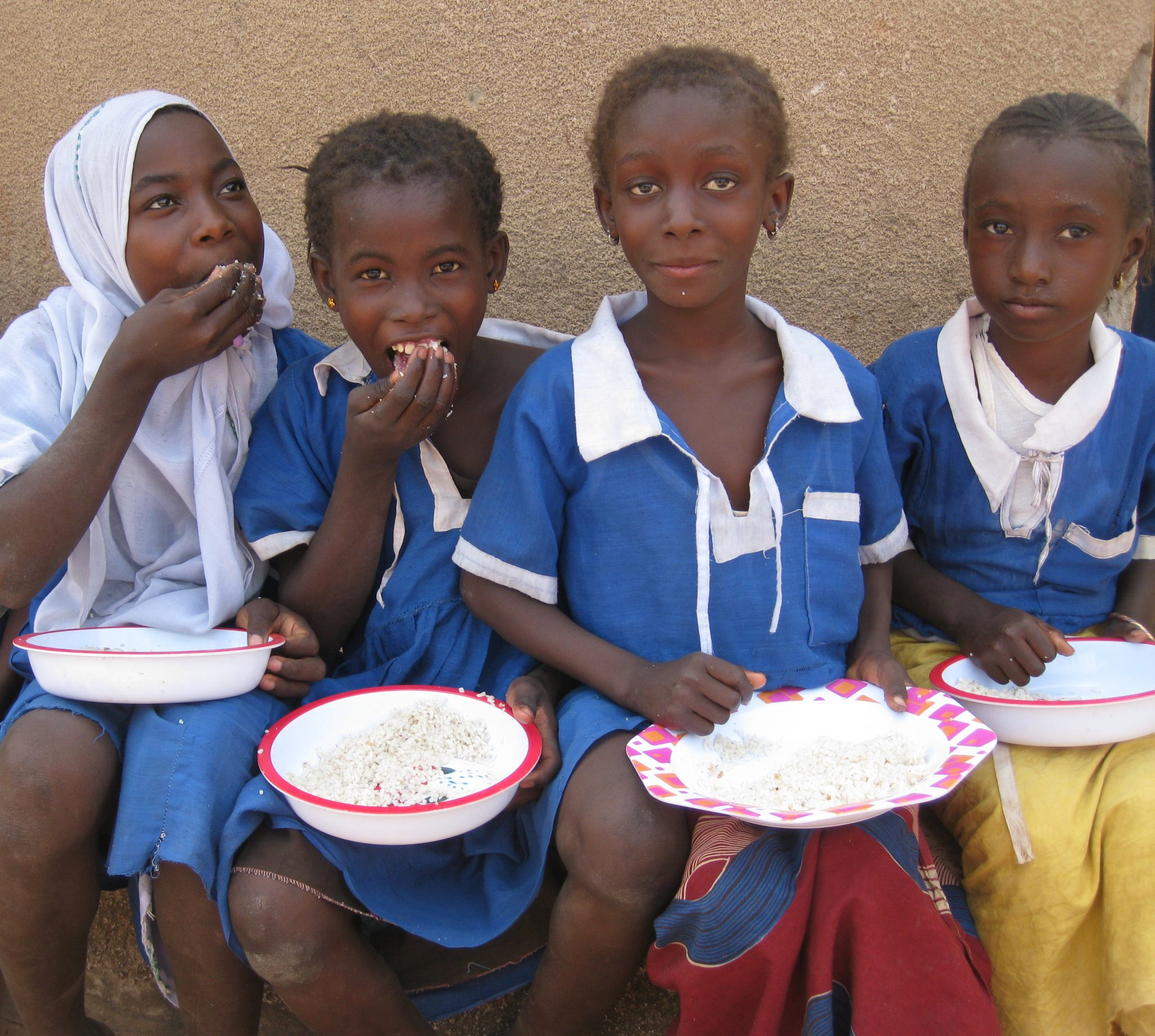 Four children eating a school meal