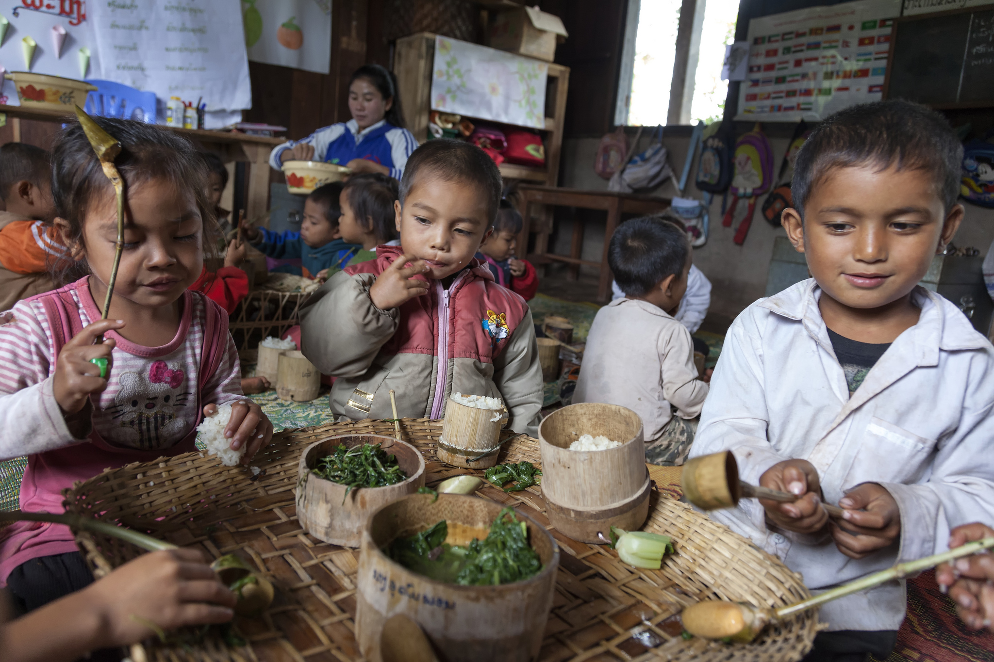 Children in Laos eating school meal