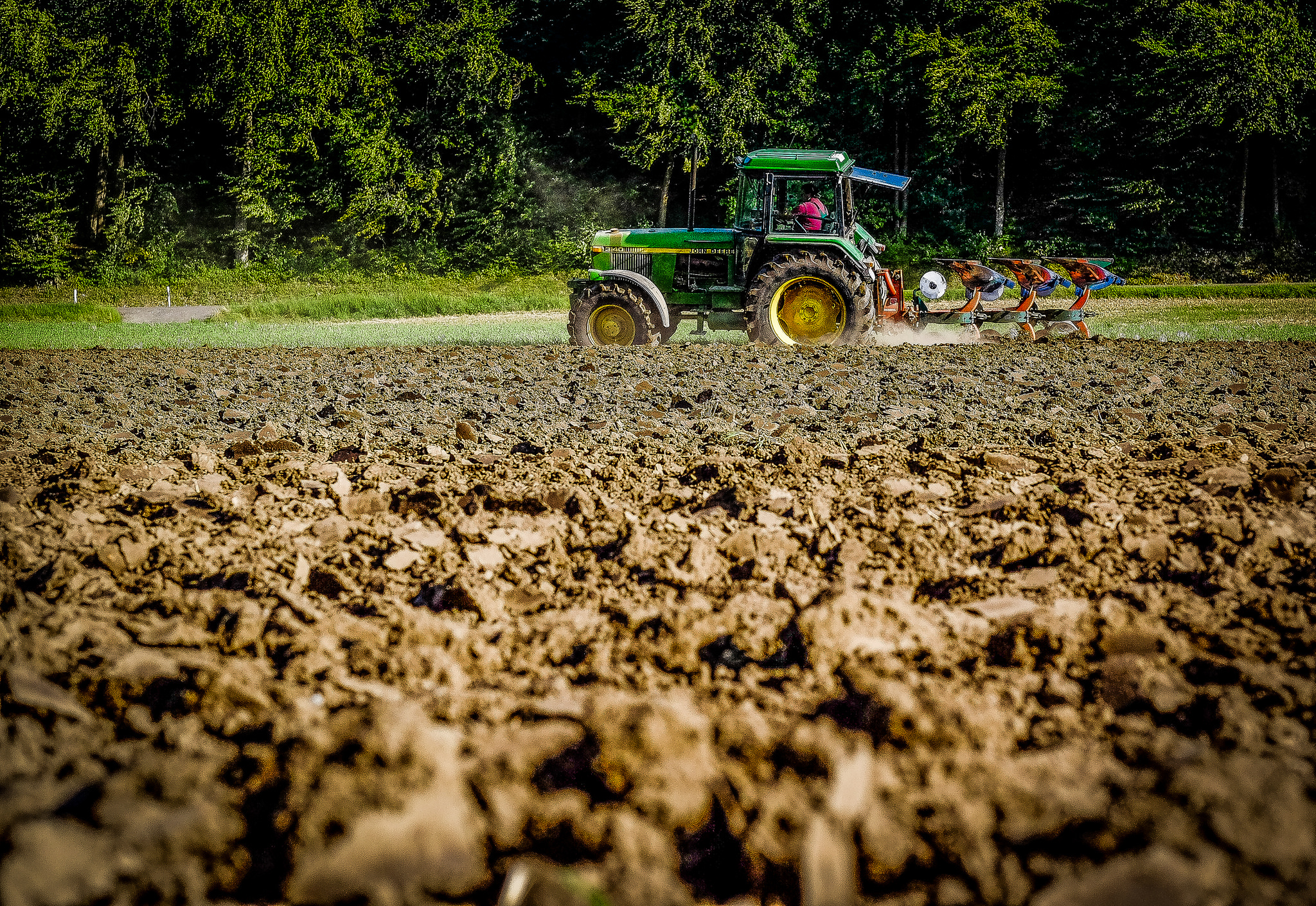 Tractor digging over a field