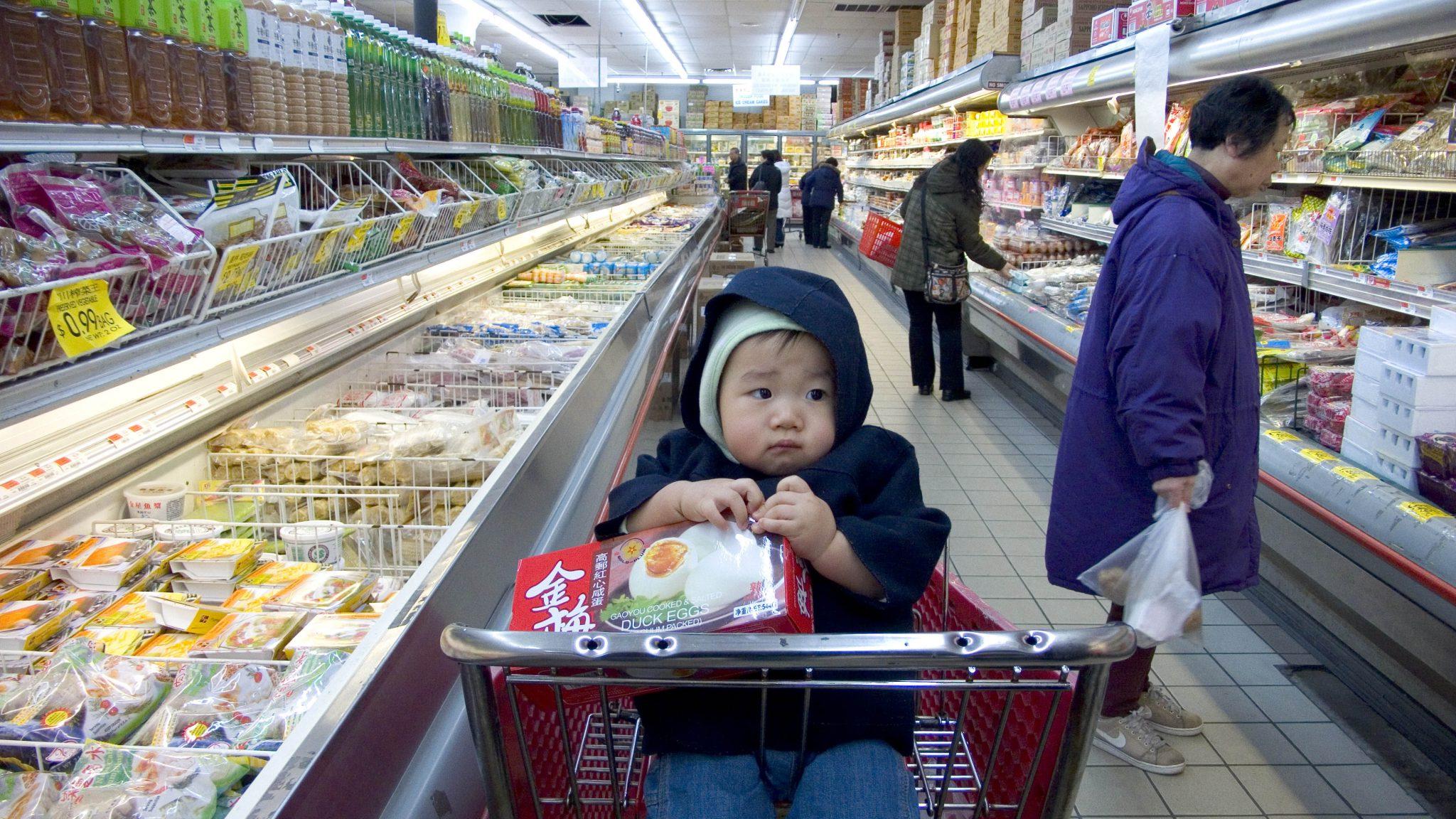 Baby in supermarket trolley
