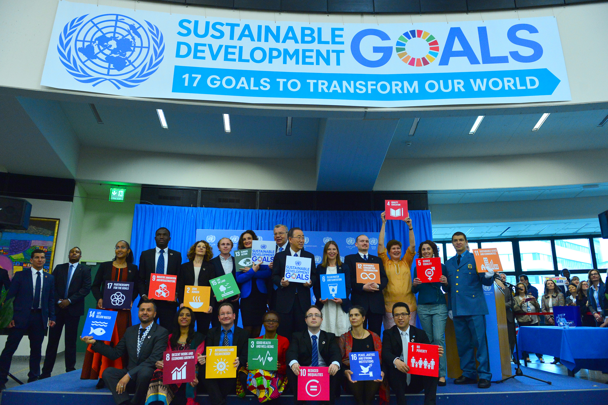 United Nations Secretary-General Ban Ki-moon and seventeen staff each hold a card for one of the Sustainable Development Goals