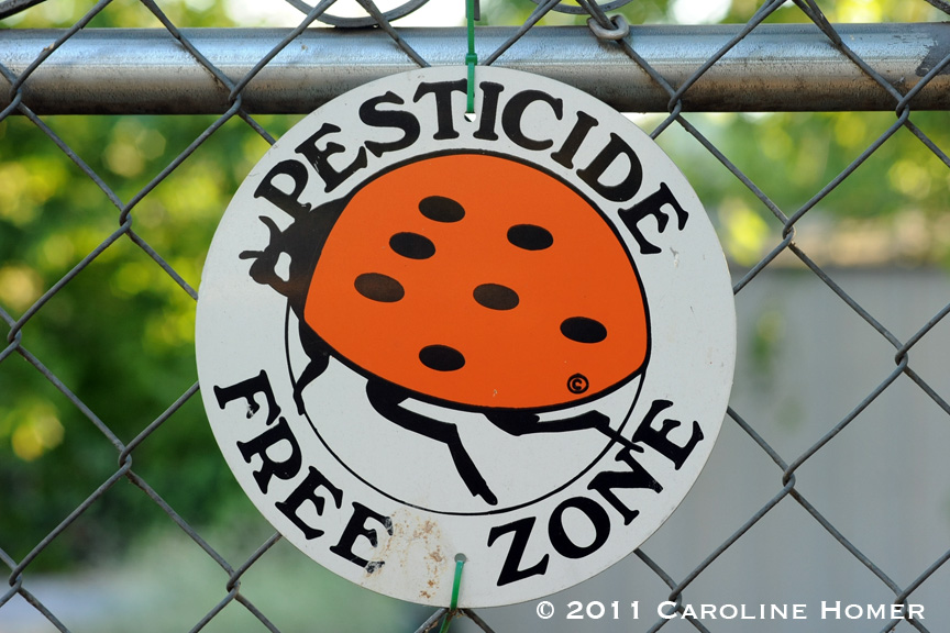 Pesticide free zone sign on a fence