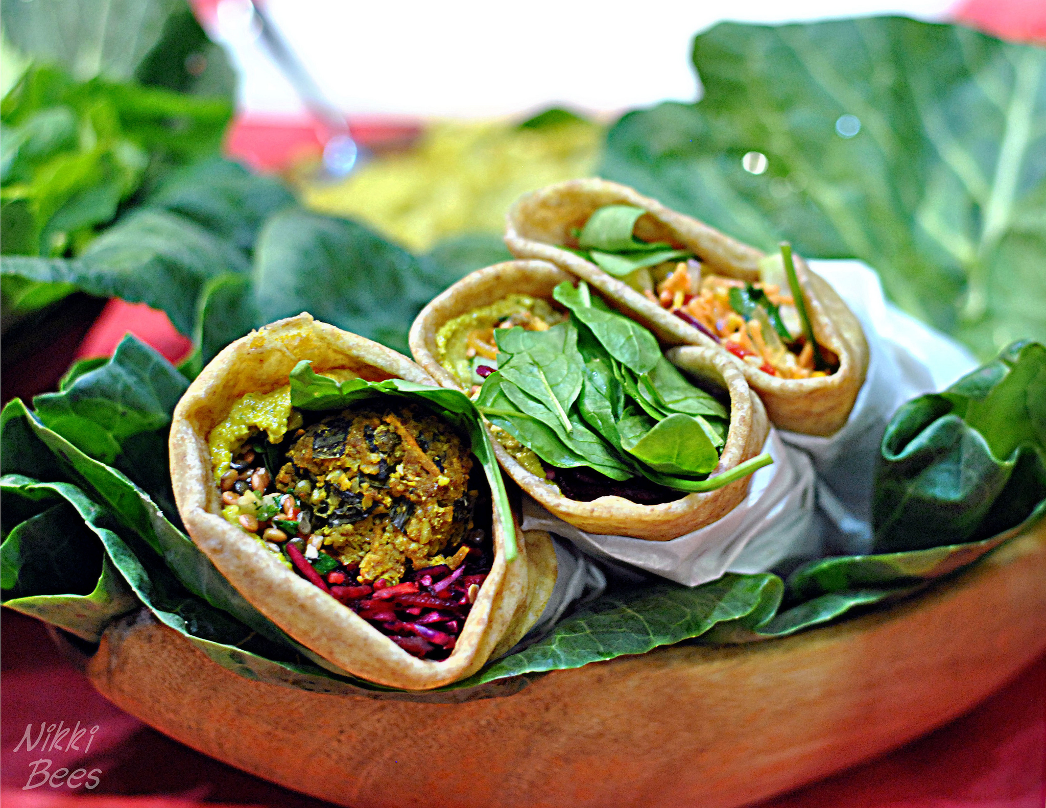 A vegan wrap on salad leaves