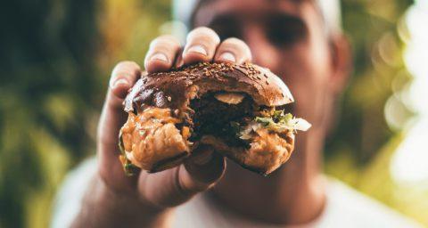 A man holding a burger